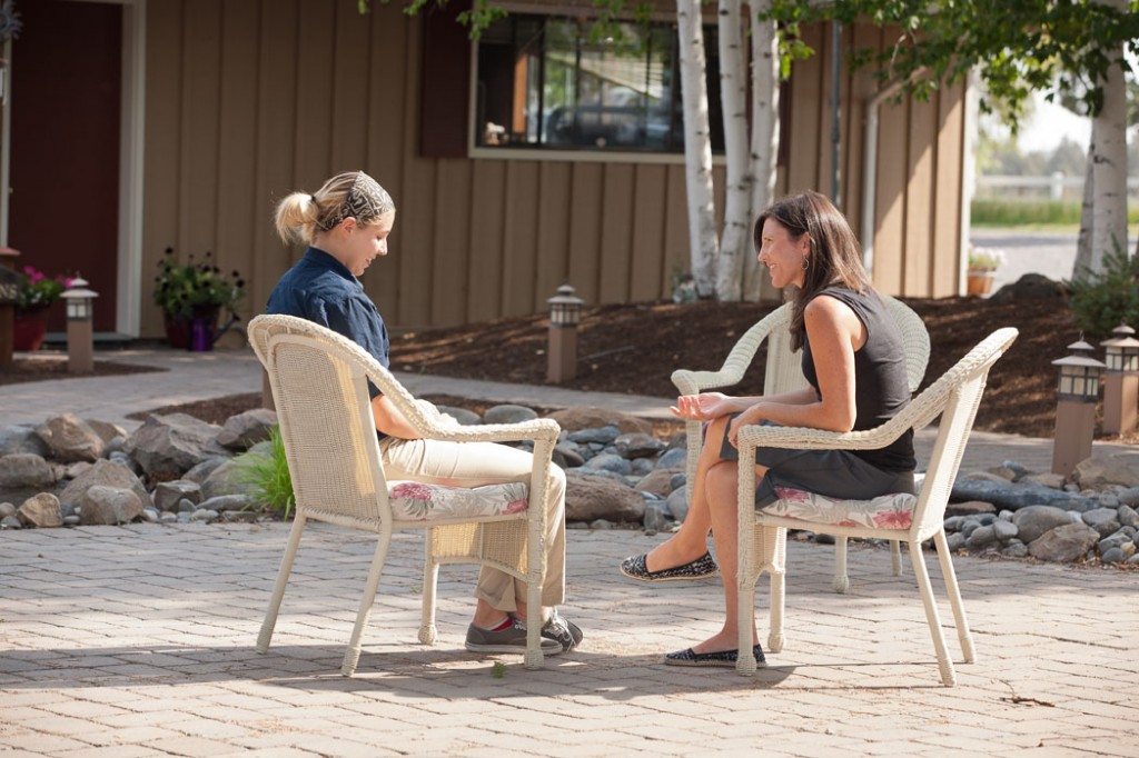 A girl talking with her therapist at a boarding school