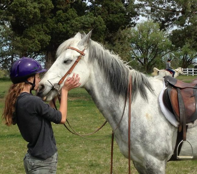 Girl loving her horse after a ride