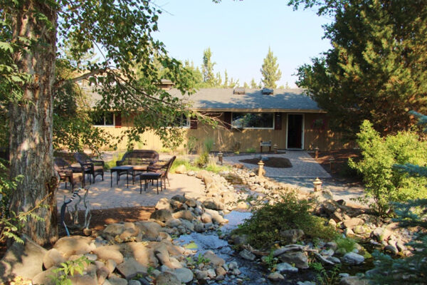 grounds with a patio and creek at a therapeutic boarding school