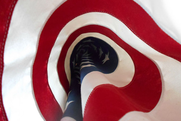 photo of the American Flag coiled by a student at a boarding school