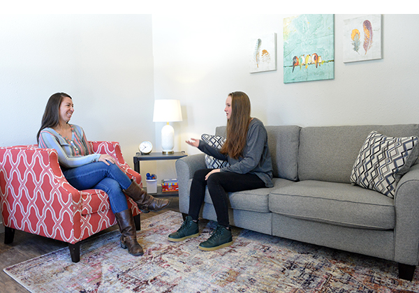 therapist and girl talking in a therapy office at a boarding school
