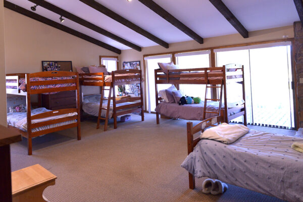 As girls arrive, they live in one of three bedrooms in the main house.